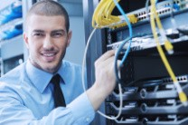 IT technician attending to server.