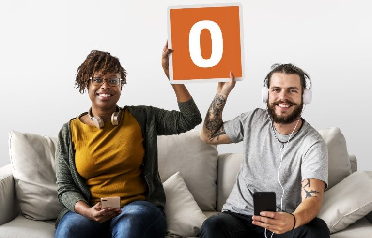 Man and woman holding up copy of web icon for Obooko