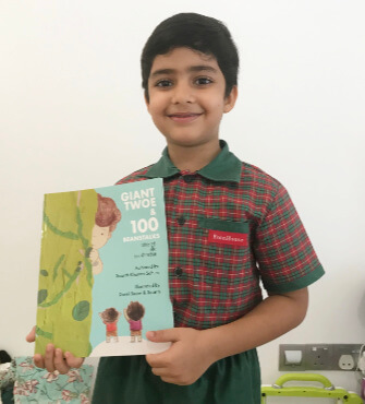 Saarth Khanna Sohum holding his book, Giant Twoe.