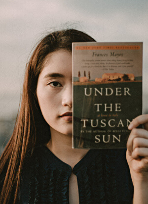 Woman holding book - Under a Tuscan Sky