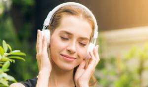 Woman wearing headphones listening to audiobook