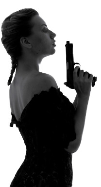 Sideview of mysterious woman holding gun gun